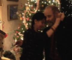 Dancing in front of Christmas Tree