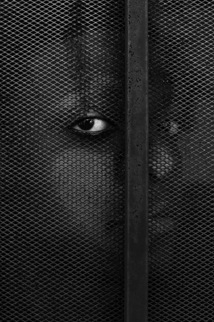 Black face through fence, Gioncarlo Valentine©2020, journal of wild culture