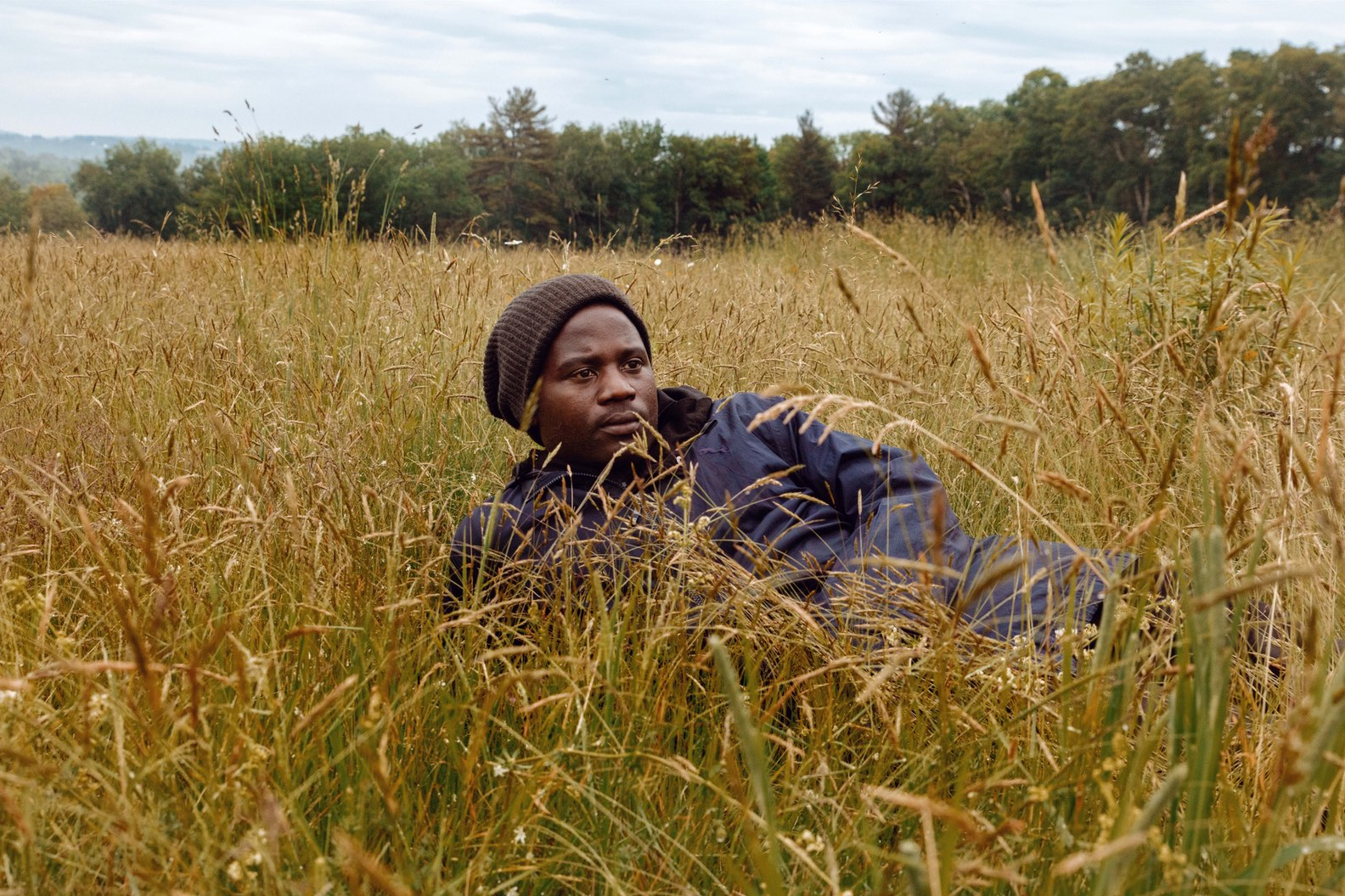 Man laying in grass, Gioncarlo Valentine ©2020, journal of wild culture