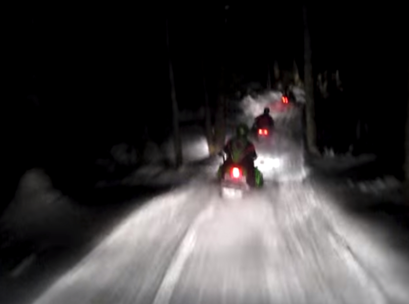 snowmobiles at night, journal of wild culture